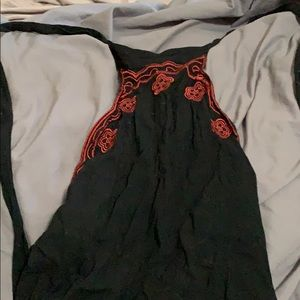 Black halter dress with red floral